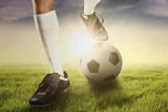 Football player exercising to kick the ball Royalty Free Stock Photo