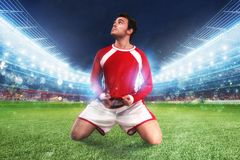 Football player exults in a full stadium. Football player exults in a stadium with audience stock photos