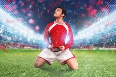 Football player exults in a full stadium. Football player exults in a stadium with audience stock images