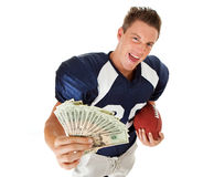 Football: Player with Fanned Money and Ball. Caucasian American football player, in uniform, isolated on white, with various related props Stock Images