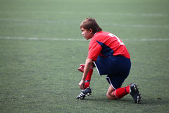 Football player fastening laces Stock Photography