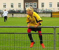 The football player on the fence Royalty Free Stock Photography