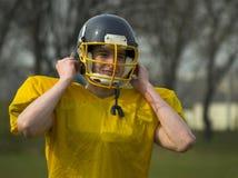 Football Player Fixing Helmet royalty free stock image