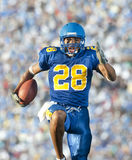 Football player in game action stock image
