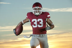 Football player in game action Royalty Free Stock Photography