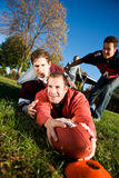 Football: Player Gets Tackled By End Zone. Series of a group of friends playing football in the park on an Autumn day Royalty Free Stock Photography