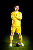 Football player on grass field. Sport portrait royalty free stock image