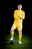 Football player on grass field. Sport portrait royalty free stock images