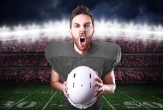 Football Player on gray uniform in the stadium Royalty Free Stock Images