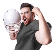 Football Player on gray uniform on white background Royalty Free Stock Image