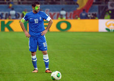 Football player with green laser on face during FIFA World Cup Playoff Game Stock Photo