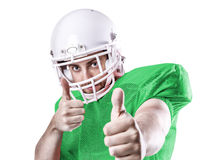 Football Player on green uniform on green background Royalty Free Stock Photography