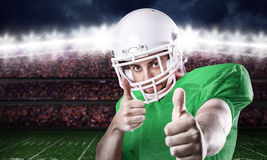 Football Player on green uniform in the stadium Stock Photography