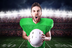 Football Player on green uniform in the stadium Royalty Free Stock Photography