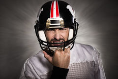 Football player with helmet Royalty Free Stock Photo