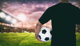 Football player holding ball on football stadium of championship. Win for background Stock Image