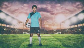 Football player holding ball on football stadium of championship royalty free stock photos
