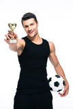 Football player holding winners cup Stock Image