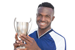 Football player holding winners cup Royalty Free Stock Photography