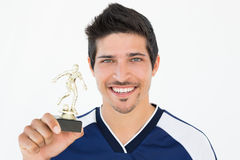 Football player holding winners trophy Stock Images