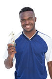 Football player holding winners trophy Stock Photography
