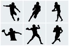 Football player icons and silhouettes Royalty Free Stock Images