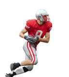 Football Player Isolated. A football Player running with the ball isolated on a white background stock images