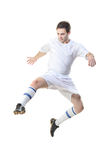 Football player in jump. Isolated against white background royalty free stock image