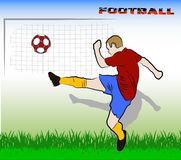 Football player kicking the ball Stock Images