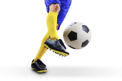 Football player kicking the ball stock photography