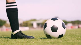 Football player kicking the ball stock video footage