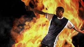 Football player kicking the ball. On flaming background stock video footage