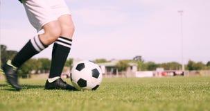 Football player kicking the ball stock video