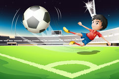 A football player kicking a ball Stock Photo