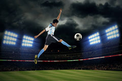 Football player kicking ball Stock Photos