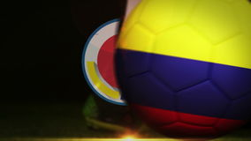 Football player kicking colombia flag ball stock video