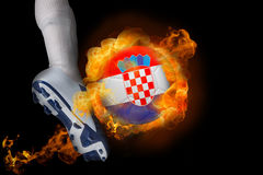 Football player kicking flaming croatia ball Stock Photo