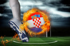 Football player kicking flaming croatia flag ball Royalty Free Stock Image