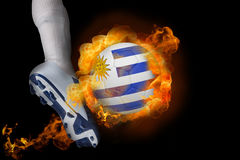 Football player kicking flaming uruguay ball Royalty Free Stock Photography