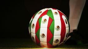 Football player kicking mexico flag ball stock video