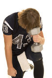 Football player kneel on weight Stock Image