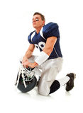 Football: Player Kneeling with Helmet Stock Photography