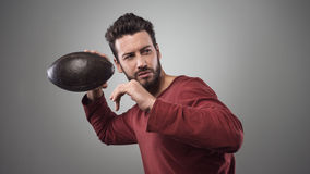 Football player launching ball Royalty Free Stock Image