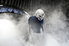 Football Player. Leaving a smoky tunnel, ready to get on the field Royalty Free Stock Photography