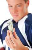 Football: Player Looking at Roll of Cash Stock Images