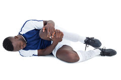 Football player lying down injured Royalty Free Stock Image