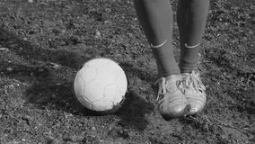 Football player on a muddy pitch,black and white stock video