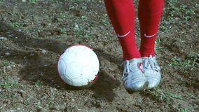 Football player on a muddy pitch,slow motion dribbling stock video