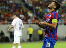 Football player negative reaction. Steaua's Cristian Tanase angry reaction after missing the target during the UEFA Champions League 2nd round game between Royalty Free Stock Images