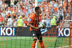 Football player in the net Stock Image
